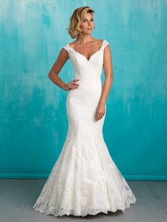 Scalloped lace makes a subtle statement in this understated yet sexy gown. Alluring mermaid wedding dress made of lace with cap sleeves, v-neckline. Long tail.