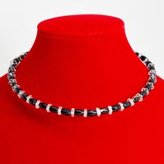 There may be no more versatilewardrobe staple than a black stone choker. Wear it to the office; wear it to dinner anddrinks; wear it with a simple white T. Equal parts substantial and sweet, this black agate and pale pink Czech glass choker lendsrestrained elegance to any look. Memory wire is easy to wear and care for. It expands to fit all without losing its shape.  The Smallest Planet Guarantee  All Smallest Planet jewelry is handmade by me, Sara Kelly, in my home studio in San Diego…