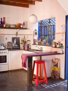 Beautiful and art-filled kitchen from Las Cositas de Beach & eau. Love that one red stool under the counter. | Tiny Homes