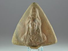 Roman oil lamp handle with Isis, 2nd-3rd century A.D. Roman iol lamp handle, Roman Egyptian terracotta two wicks oil lamp handle with Isis, 8.7 cm long. Private collection