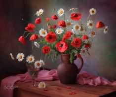 Still life with a bouquet of poppies and chamomile by Tatiana Skorokhod on 500px