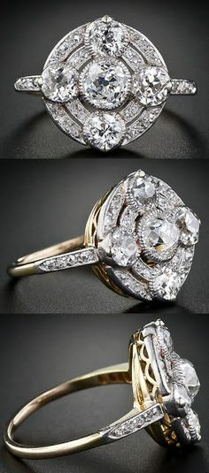 Circular antique diamond ring from the early 1900s...  Five antique old mine-cut diamonds - the central diamond weighing a half-carat
