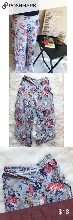 Casual Floral Split Side Pants L Unique split side pants. Cropped. 100% rayon. Gray with floral print. Perfect for the beach! Juniors size L, but run a bit big. Elastic waist. B9  Please note, this listing is for pants only. All other items in the gallery photo are there for style purposes and are not included in this listing. Please reach out to me if you have any questions. Pants