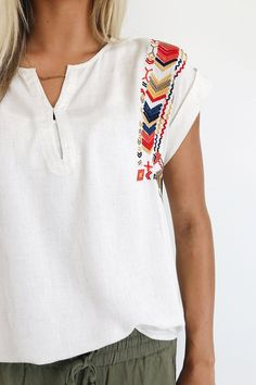 Cream Linen Blouse    Embroidery Detailing    Cap Sleeve w/Cuff    Concealed Button Keyhole on Front    Loose Fit