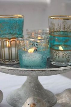 Candles in pretty turquoise, clear and gold glass candle holders