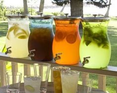 Assorted colorful drinks like lemonade, iced tea, and punches look great served in clear containers and allows guests to serve themselves at your backyard vow renewal