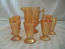 Hello!    I am so very happy to offer this set of 8 goblets and pitcher made by the Jeanette Co. From the carnival glass era and in mint
