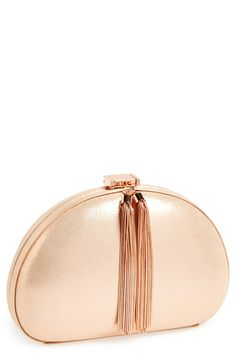 Elegant rose gold clutch with tassel.