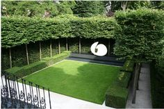 Chelsea Show Garden - Pleached trees with hedge walls, low hedging and turf