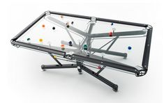 Revolutionize your indoor recreation space with a modern pool table by Elite Innovations. Their new, patented technology, Vitrik, promises to replicate the exact rolling resistance of a standard felt table on toughened glass rather than slate.
