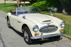 This white 1967 Austin Healey 3000 MKIII is an excellent weekend driver. It runs, drives, shifts, and brakes wonderfully. The white on red color combination is fantastic and the car is quite presentable as is. The soft-top is also in good condition. Here's your chance to own a very original and solid example for only $27,500