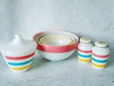 """Classic Anchor Hocking/Fire King nesting mixing bowl set, grease jar with cover and shaker set in pastel stripes/bands or better known as """"Colonial Bands."""""""