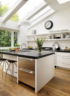 Angled skylights in bright airy kitchen