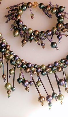 Glass pearls with long bugles and crystals -   thread your needle and go back in and between each pearl to embellish.
