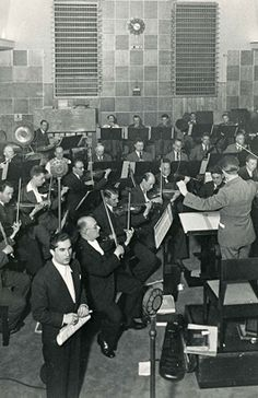 Joseph Schmidt during a live broadcast. The studio design was experimental, and so successful it is still used today. The acoustic panels on the walls could be flipped to reflect or deaden sound. Joseph Schmidt, Opera Singers, Acoustic Panels, Studio Design, Walls, History, Live, Concert, Archive