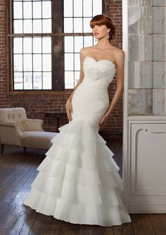 Mori Lee 4801 Size 6 White Look fabulous for less! Visit www.bridaloutletofamerica.com for the best deals on gowns you love.