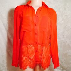 Stylish red orange blouse with lace Stylish red orange blouse with lace. 100% Polyester. Botton down with 2 pockets in front. Botton tab long sleeves. I believe you will love it very much. INA Tops Blouses