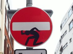 PHOTOS: London Traffic Sign Artbomber Uses Stickmen to Question Government