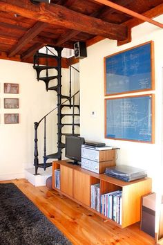 Once architectural blueprints are done serving a practical function, you can still keep them around for decorative reasons. In Chris and Erin's farmhouse in Massachusetts, two framed blueprints bring color to the downstairs living room.