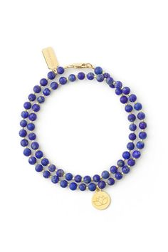 This Lotus Flower Wrap Bracelet is made with Lapis Stone gold-filled closures high quality micro-beads gold-plated Lotus Flower Charm and TessTricia charm. Lotus flowers are a symbol of purity peace growth and rebirth. This bracelet is a total beaded length of 14. This piece typically fits looser around the wrist and allows for some natural movement. This fit was specifically designed to have the ability to mix and overlap with other bracelets worn together.  Lapis Double-Wrap Bracelet by…