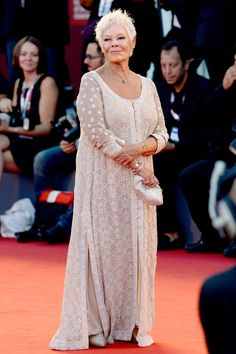 "Ms. Dench has favored the Indian designers Abu Jani and Sandeep Khosla, wearing their delicate cream lace gown for the premiere of ""Philomena."""