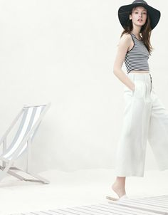 J.Crew Apiece Apart cropped tank top, Apiece Apart Taiyana wide leg pant, wide-brimmed straw hat in black and Valencia perforated leather espadrille slides.