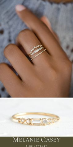 A unique stacking ring featuring a row of diamonds in various cuts, with a baguette cut diamond at the center. Find this sleek 14k gold band at melaniecasey.com!
