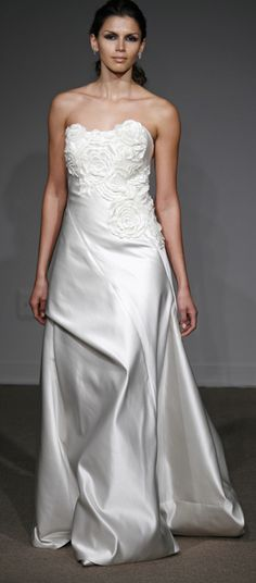 With draped bodice and architecturally drape skirt wedding dress