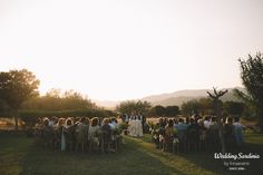 Outdoor garden wedding at sunset in a country venue in Sardinia