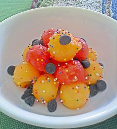 Watermelon, cantaloupe, chocolate chips, and sprinkles. Awesome snack for a kid!