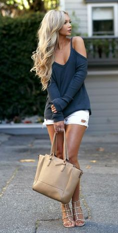 Cool sweater with cut-outs with pair of white shorts looks perfectly for walks