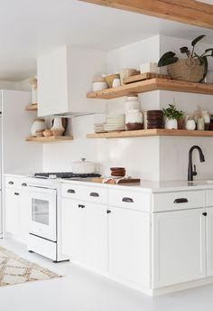 crisp white boho style kitchen, shelves wrap around the corner All White Kitchen, Country Kitchen, Rustic Kitchen, Tuscany Kitchen, Eclectic Kitchen, Boho Kitchen, Primitive Kitchen, Scandinavian Kitchen, French Kitchen