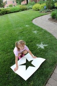 decorate your lawn with large stencils and a dusting of flour.  @Rachel Cassels-Brown, Would be cute with dino prints for an outdoor party or for the front lawn entrance  Would be great to announce birthdays, anniversaries or to make huge game boards for games.  So many possibilities.  Holidays... ps