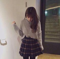 grayish beige oversized sweater - dark blue plaid a line skirt - black tights