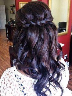 Deep brown tinted hair. Curls. Braid