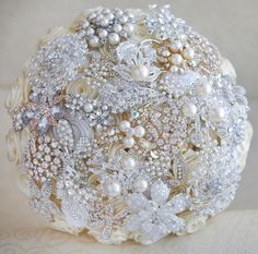 black and gold brooch bouquet | gold wedding broochesBrooch bouquet Ivory white silver and gold ...