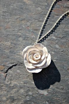Rose ceramic necklace by Dprintsclayful on Etsy,