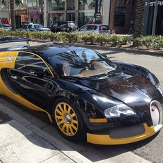 Bijan's Black And Yellow Bugatti Veyron SuperSports - parked in front of his store <3