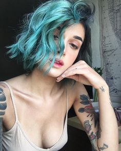 Teal black hair color and wavy haircut idea