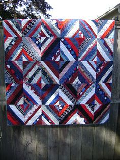 And this red, white and blue one was done with a rectangular block to accentuate the diamond shape.  This would make a great picnic quilt!