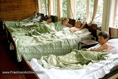 This is a picture from a boys' summer camp, but I'm seriously wanting to do a boys' dorm room like this in our basement.