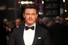 Actor Luke Evans poses for photographers upon arrival at the Olivier Awards in London, Sunday, April 3, 2016. (Photo by Joel Ryan/Invision/AP)
