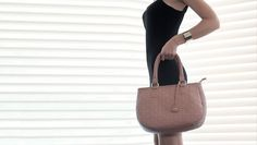 # A classy diamond quilted hand bag. http://bit.ly/1vMp4JW