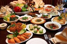Dinner is prepared by the females of the house and it is said that the male teenager should never prepare his own meal. Table settings are arranged family style and every member of the family is expected to eat together as a community.  http://yfuusa.org/media/yes_lounge/Lebanon.pdf http://coloradoboulevard.net/10-things-i-like-about-arabic-thanksgiving-dinners/