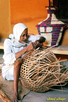 Old basket maker - Bahrain صــانع الســلال    It is one of the oldest handicraft in Bahrain . This old man is blind but he can do beautiful things ! He brings these materials from palm trees .