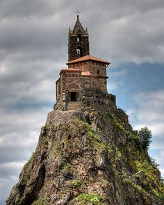 Saint-Michel d'Aiguilhe chapel (Le Puy-en-Velay, France). Perhaps one of the most remarkable sights in France, a chapel perched on a volcanic plug. This is the Rock of Aiguilhe, on the edge of the town of Puy en Velay, in the Auvergne. The Places Youll Go, Places To See, Beautiful World, Beautiful Places, Amazing Places, Wonderful Places, Belle France, Cathedral Church, Old Churches