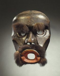 Dzunuk'wa Cannibal Woman Mask  Culture: Kwakwaka'wakw                    Medium: Cedar wood, fur (black bear?), hide, pigment, iron nails           Place Made: Vancouver Island, Knights Inlet, British Columbia, Canada         Dates: 19th century  Brooklyn Museum