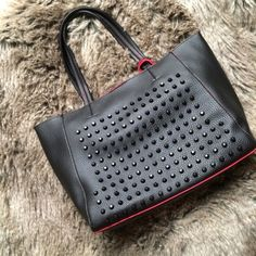 """Red/black studded 3-in-1 faux leather tote bag This 3-in-1 tote is a faux leather material, studded on one side, two-tone colors. Two small coordinating bags, one coin purse sized, one cross-body sized with removable strap. Direct from vendor, does have some manufacturing imperfections on the inside, see picture. Snap closure on large bag, zipper closures on small bags.  L(H:10"""", W:17"""", D:6""""), M(H:8.5"""", W:10"""", D:2.5""""), S(H:5.5"""", W:7.25"""") NO TAGS Bags Totes"""