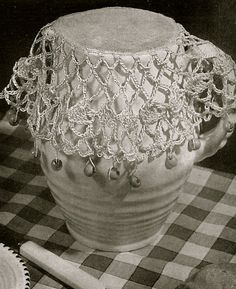 This is a vintage crochet pattern sourced and republished by Vintage Visage  It will be sent as a link via email to a downloadable pdf file within 5- 10 minutes of your payment of your payment    This is a crochet pattern for very pretty lace stitch milk jug cover or sugar bowl cover- these were used to keep flies and insects from entering and contaminating milk and sugar during afternoon teas or picnics- very downton abbey!    Vintage Visage specialise in reproducing patterns from the past…