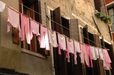 Pink wash in Cinque Terre | Smelly Towels? | Stinky Clean Laundry? | http://WasherFan.com | Permanently Eliminate or Prevent Washer & Laundry Odor with Washer Fan™ Breeze™ | #Laundry #WasherOdor  #SWS